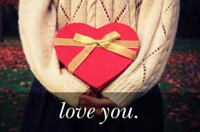 Image of a red gift in the shape of a heart with the text
