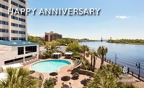 "eGift Card image of the hotel pool with the text ""Happy Anniversary"" and the Hotel Ballast logo"