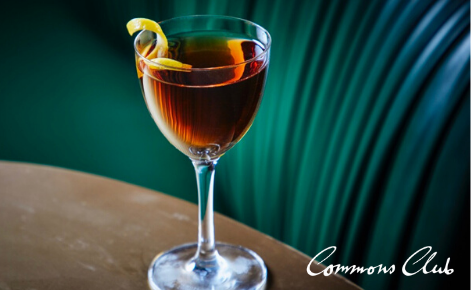 Gift card image of cocktail with the Commons Club logo
