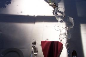 Image of cutlery and glasses on table