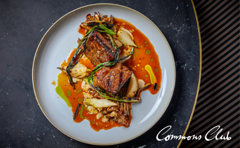 Gift card image of food with the Commons Club logo
