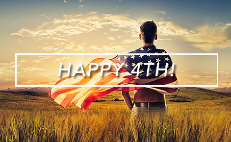 Gift card image of man standing in a field with the American flag wrapped around him and the text