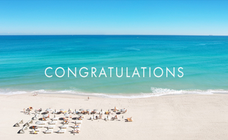 "Gift card image of sun loungers on the beach with the text ""Congratulations"""
