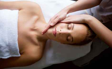 Image of lady receiving a head massage