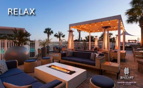 "eGift Card image of exterior shot of hotel with the text ""Relax"""