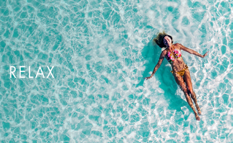 "Gift card image of lady floating in the ocean with the text ""Relax"""