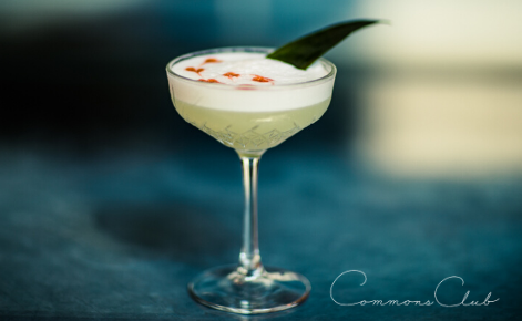 Gift card image of a cocktail with the Commons Club logo