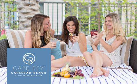 Gift card image of ladies enjoying a drink with the Cape Rey Carlsbad logo