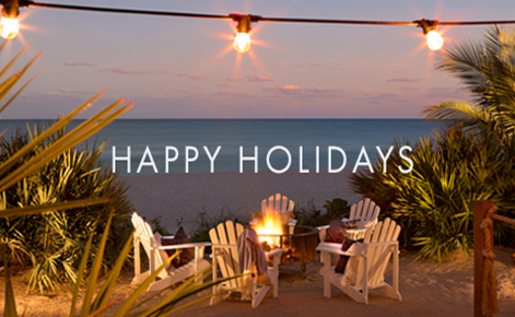 "Gift card image of seating on the beach at sunset with the text ""Happy Holidays"""