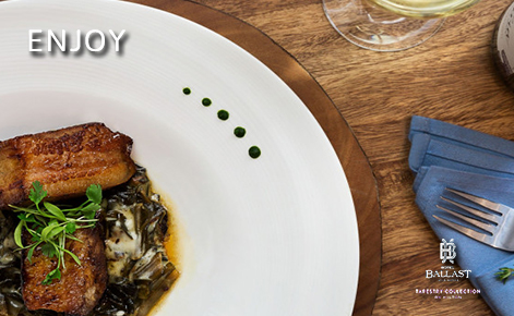 "eGift Card image of restaurant meal with the text ""Enjoy"" and the Hotel Ballast logo"