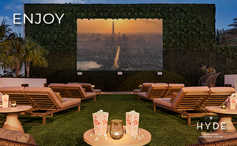 """eGift Card image of the roof top cinema at night with the text """"Enjoy"""" and the Hyde Beach House logo"""