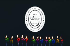Image of lit candles with Salt Factory Pub logo