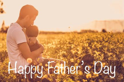 Image of father hugging child in field at sunset with the text