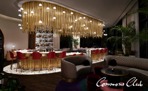 Gift card image of restaurant with the Commons Club logo
