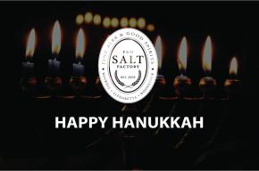 Image of lit Hanukkah candles with the text