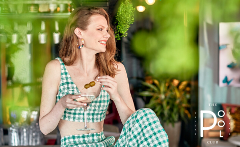 Gift card image of lady enjoying a cocktail with the Pool Club logo