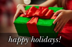 Image of a gift wrapped present in green with the red ribbon and the text