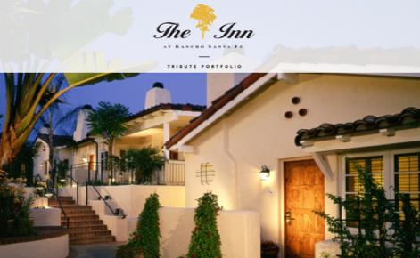 External shot of The Inn at Rancho Santa Fe at night with logo overlaid at the top