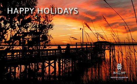 "eGift Card image of the sunset over their jetty with the text ""Happy Holidays"" and the Hotel Ballast logo"