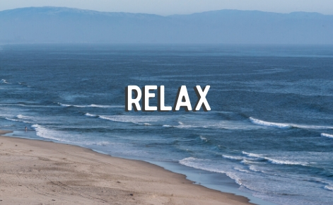 "Gift card image of the ocean with the text ""Relax"""
