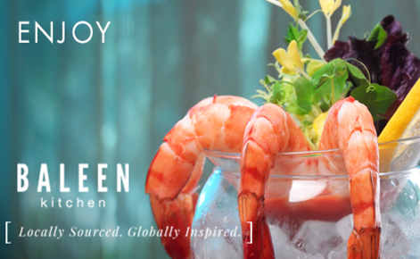"""Gift card image of seafood from the restaurant with the text """"Enjoy"""" and the Baleen logo"""