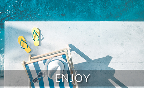 Image of flip flops, deck chair and hat by the pool with the text