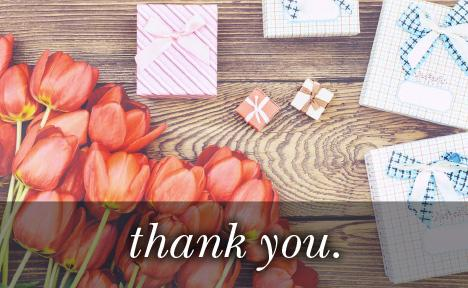 Image of tulips and various sized gifts with the text
