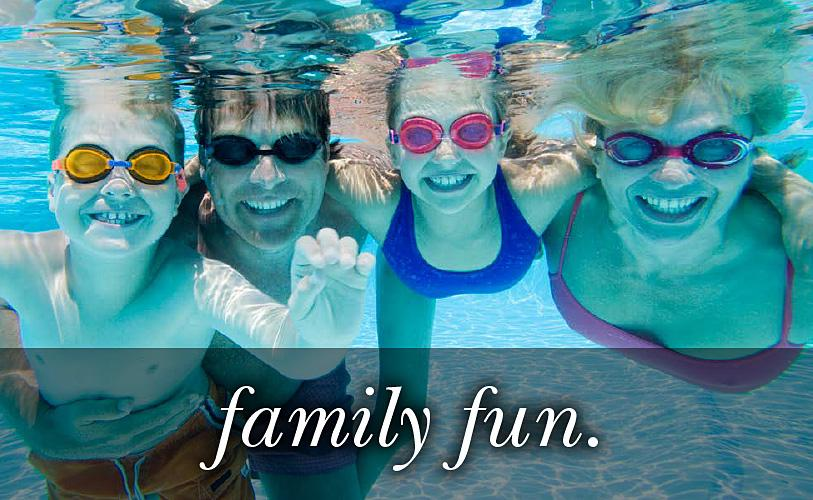 Image of a family in the pool under water looking at the camera with the text