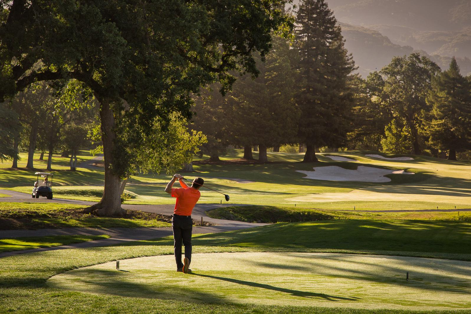 Image of man taking a golf shot