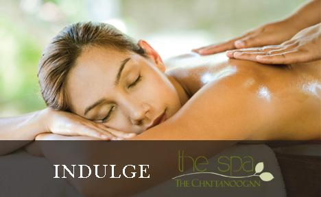 Image of lady receiving a massage with the text 'Indulge