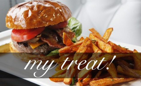 Photo of burger and fries with the text