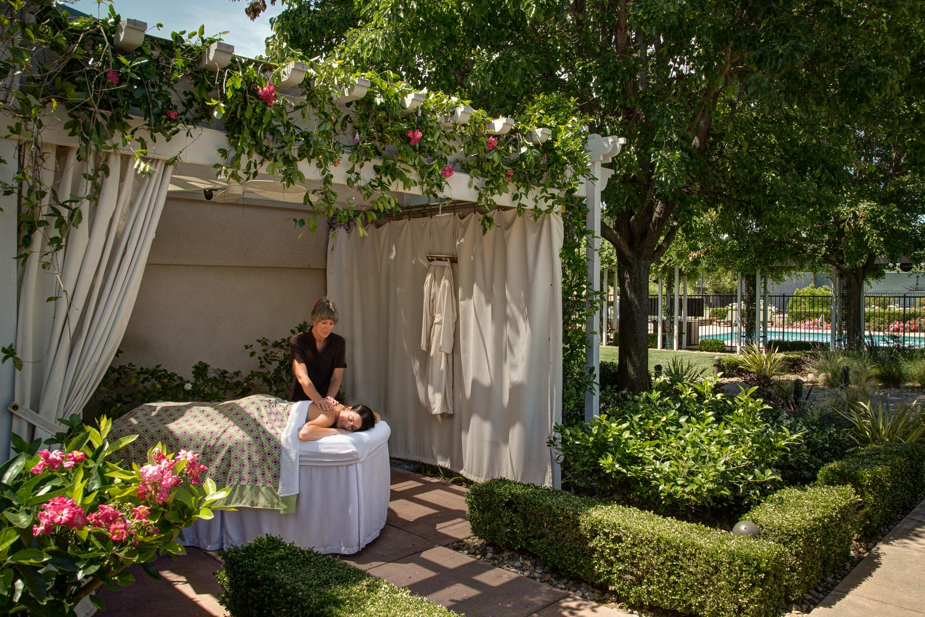 Image of lady receiving and outdoor massage
