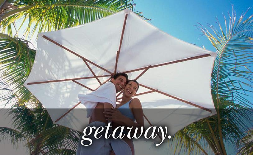 Image of a couple under a parasol with the text