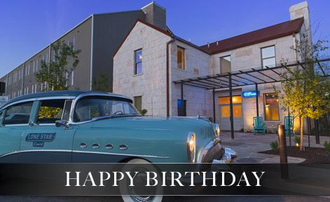 External image of hotel with vintage car in forefront with the text