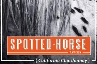 Close up image of a horse with the Spotted Horse logo