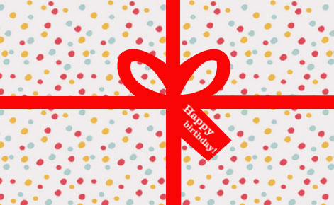 Image of a polka dot wrapped gift with red ribbon
