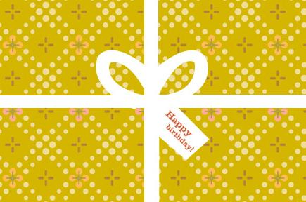 Image of gold wrapped gift with white ribbon
