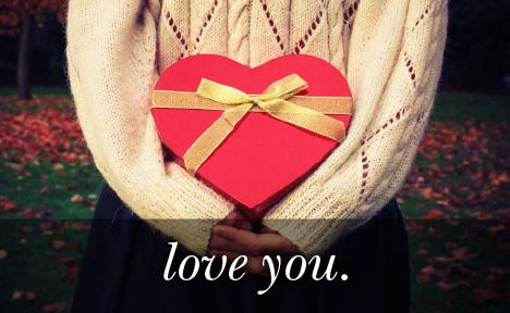 Image of a heart shaped gift with the text