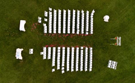 Aerial of Wedding Seating with Flower Petals