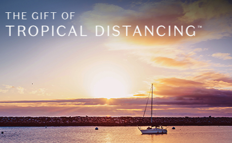 Gift card image of a sailing boat out at sea at sunset with the text