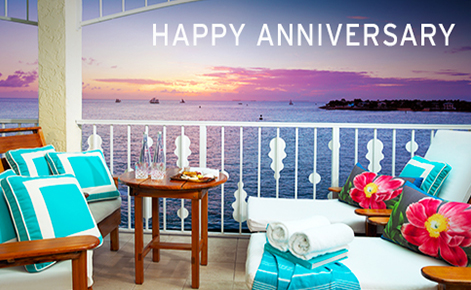 """Gift card image of the view from the balcony at sunset with the text """"Happy Anniversary"""""""