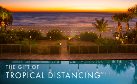 Gift card image of the pool and beach at sunset with the text