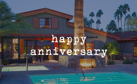 """Gift card image of the pool and hotel at dusk with the text """"Happy Anniversary"""""""