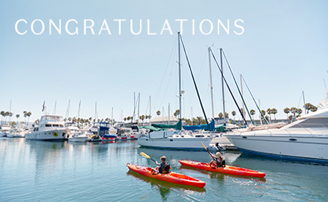 """Gift card image of two kayakers in the marina with the text """"Congratulations"""""""