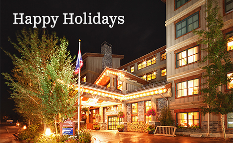 "Gift card image of the exterior of the hotel with the text ""Happy Holidays"""
