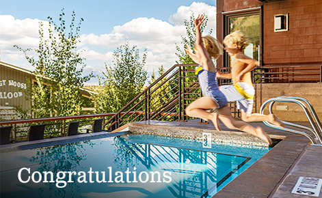 "Gift card image of two children jumping into the pool with the text ""Congratulations"""