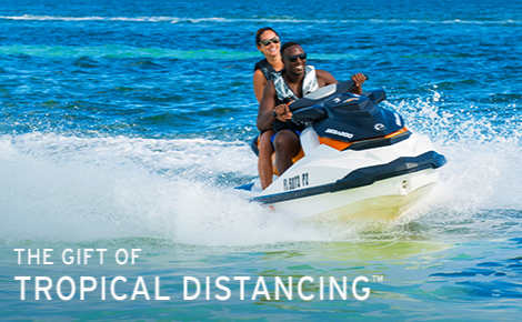 Gift card image of couple on jet ski with the text