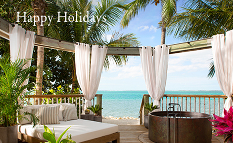 "Gift card image of seating area overlooking the ocean with the text ""Happy Holidays"""