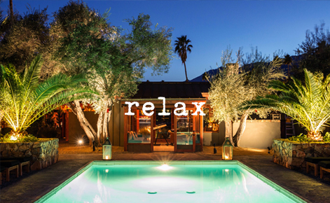 """Gift card image of the pool at night with the text """"Relax"""""""
