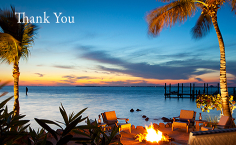 "Gift card image of the our door beach seating area with fire put at sunset with the text ""Thank You"""